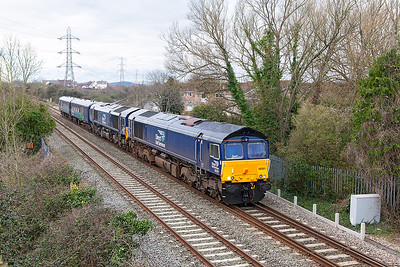 66301 & 66424 pass Worle Junction with 5M63 11.28 Exeter Riverside to Crewe CLS with Escort coaches 9419 & 9428 after working a flask train to Devenport on the 8th March. Friday 10th March 2017.