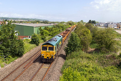 66549 heads along the Weston-super-Mare avoiding line at Winterstoke Road with the Track Replacement Train running as 6X04 08.00 Maindee East Junction to Taunton Fairwater Yard. 66545 is at the rear of this very long train. Sunday 11th June 2017.