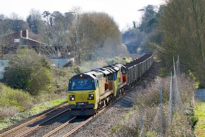 70806 drags failed 70807 with 6C28 13.45 Exeter Riverside Yard to Westbury Down Yard empty stone wagons past Uphill Junction. Diverted via Bristol due to the derailment at East Somerset Junction. Wednesday 22nd March 2017.