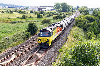 70817 passes Flowerdown Bridge on the Weston-super-Mare avoiding line with 6C36 11.38 Moorswater to Aberthaw Cement Works empty PCA Cement Tanks. Thursday 22nd June 2017.