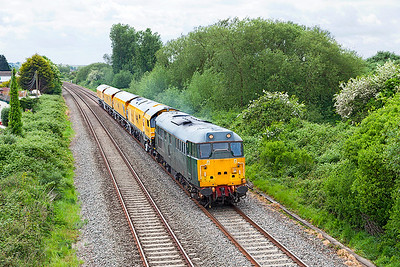 31452 returns the Rail Grinder DR79401 -Dr79404 from Oakhampton passing Hutton Moor on the Weston-super-Mare avoiding line, running as 4Z02 11.45 Oakhampton to Chaddesden Sidings. Saturday 13th May 2017.
