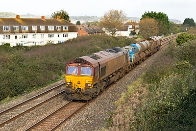 Due to engineering work on the Castle Cary route, the St Blazey RHTT was diverted via Bath running as 3J13 09.51 Westbury to St Blazey via Salisbury. After only a couple of weeks on the service 66074 & 66027 along with wagons 642020 & 642035 look very dirty indeed passing Oldmixon on the Weston-super-Mare avoiding line. Saturday 21st October 2017.