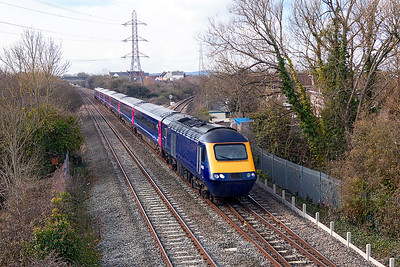 Off lease and de-branded HST power cars 43183 & 43169 with 6 de-branded coaches from set LA07 pass Worle Junction running as 5Z43 10.15 Laira Depot to St. Phillips Marsh HST Depot. Tuesday 27th February 2018.