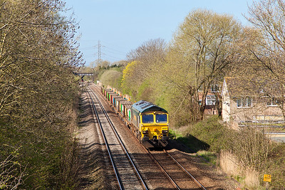 66501 'Japan 2001' has just passed Worle Junction with 4E18 09.47 Fairwater Yard to Doncaster Wood Yard re-claimed sleepers from the TRT. Wednesday 18th April 2018.