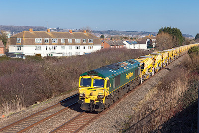 66511 passes Oldmixon on the Weston-super-Mare avoiding line with 6Y15 11.03 Filton West Junction to Fairwater Yard HOBC. 66529 is out of sight on the rear of this extremly long train. Sunday 25th February 2018.