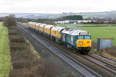 50008 'Thunderer' with Loram Rail Operations headboard passes Cripp's Bridge, Brean Road, Lympsham with new NetworkRail Loram Rail Grinder consisting of DR79501 DR79502 DR79503 DR79504 DR79505 DR79506 DR79507, running as 4Z03 08.00 Derby RTC to Okehampton. Friday 5th January 2018.