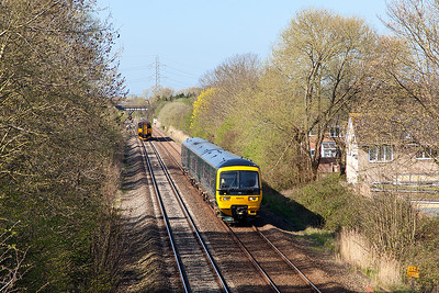 166212 heads away from Worle Junction forming 2D08 10.10 Weston-super-Mare to Bristol Parkway, as the 2C69 09.00 Cardiff Central to Penzance formed of a Class 150 gets the road take the single line into Weston-super-Mare. Wednesday 18th April 2018.