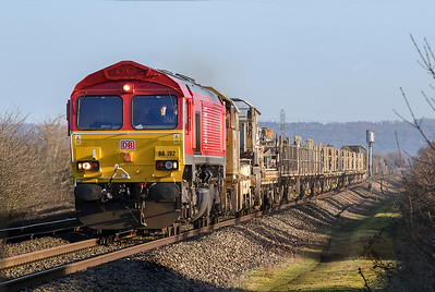 66192 passes Hewish Level Crossing with an empty long welded rail train running as 6C97 08.20 Pilning to Westbury Yard via East Usk Yard and Fairwater Yard. Sunday 7th January 2018.