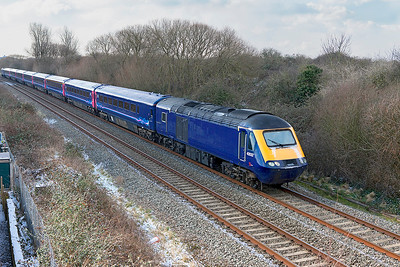 Off lease & de-branded power cars 43032 & 43168 and de-branded stock from LA74, pass Hutton Moor on the Weston-super-Mare avoiding line running as 5Z43 10:15 Laira Depot to St. Phillips Marsh HST Depot. Stock consists of 44009, 42028, 41103, 42029, 42009, 42557, 42259 & 41020. Wednesday 28th February 2018.