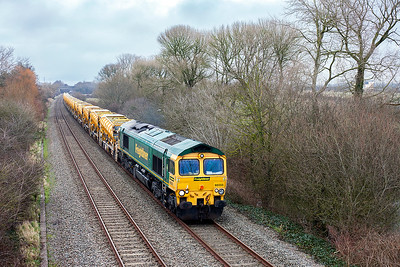 66555 passes Hutton Moor on the Weston-super-Mare avoiding line with 6C73 12.22 Westbury Down Yard to Fairwater Yard re-plenished HOBC ballast wagons. Monday 12th March 2018.