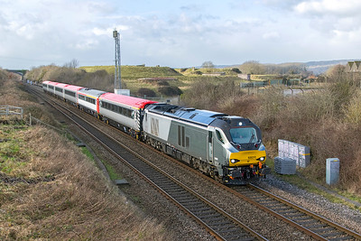 68011 passes Flax Bourton with 5Z63 10.40 Laira TMD Fuel Road to Crewe C.S. consisting of the Ex Pretendolino stock for driver training duties with Trans Pennine Express. Stock 11007, 10229, 12138, 12122, 11048 & 12011. Tuesday 16th January 2018.