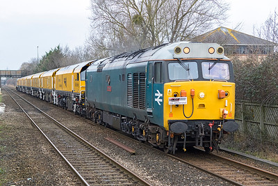 50008 'Thunderer' with Loram Rail Operations headboard passes Worle Parkway with new NetworkRail Loram Rail Grinder consisting of DR79501 DR79502 DR79503 DR79504 DR79505 DR79506 DR79507, running as 4Z03 08.00 Okehampton to Chaddesden Sidings, 56104 is DOR. Saturday 13th January 2018.