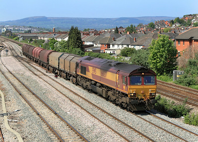 66037 passes East Usk, Newport with 6M41 11.51 Margam to Round Oak loaded steel carriers. 28/04/2011.