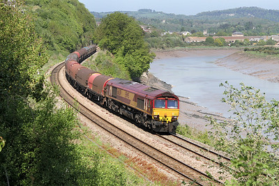 66039 skirts the River Wye at Warren Slade Wood, Bulwark with 6V05 Round Oak to Margam empty steel carriers. 28/04/2011.