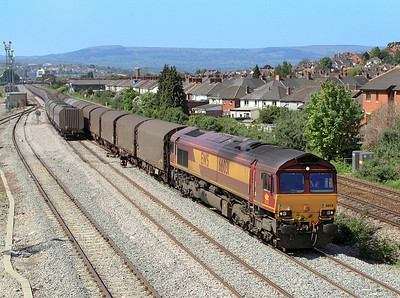 As 6V67 heads away 66031 passes East Usk with 6B03 09.10 Trostre to Llanwern. 28/04/2011.