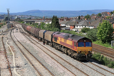 66067 heads the 6V75 09.30 Dee Marsh to Margam via Llanwern empty steel carriers past East Usk, Newport. 28/04/2011.