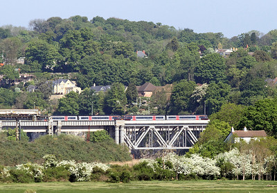 A pair of Cross Country Class 170's cross the River Wye bridge at Chepstow forming the 10.45 Cardiff to Nottingham service. 28/04/2011