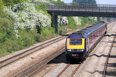 With the May blossom in full bloom 43197 & 43140 pass Llandevenny with the 12.45 Paddington to Swansea. The towers of the Second Severn Crossing can be seen above the bridge. 28/04/2011.