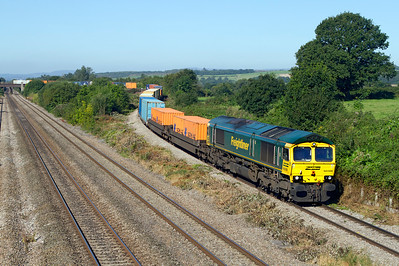 With the vegetation having been cleared between the tracks 66588 with a well loaded 4O51 09.58 Wentloog to Southampton Freightliner drops down off Bishton Flyover. Friday 7th September 2012.