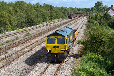66957 with one wagon in tow passes Church Road, Undy running as 6Z27 11.00 Westbury to Cardiff Canton Sidings. Tuesday 28th August 2012.