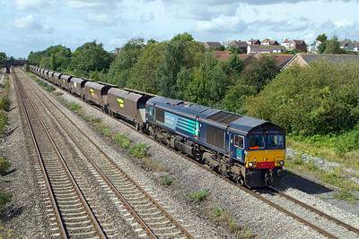 Ex DRS 66415 now with Freightliner heads 4F56 10.42 Uskmouth Power Station to Stoke Gifford Yard empty hoppers past Church Road, Undy. Tuesday 28th August 2012.