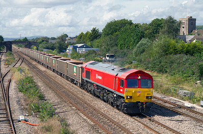 With the bell end leading 59201 passes Magor Village with 6C83 12.40 Machen Quarry to Whatley Quarry. Tuesday 28th August 2012.