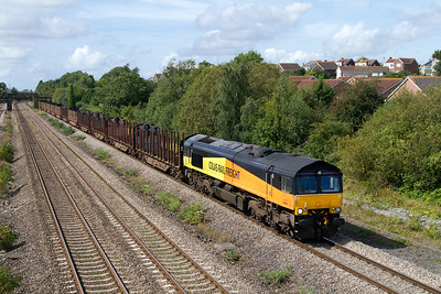 66846 passes Church Road, Undy with 6Z52 08.11 Chirk to Gloucester Yard empty log carriers prior to working to Teigngrace the following day. Tuesday 28th August 2012.
