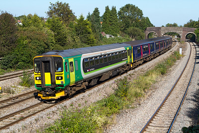 153333 still in London Midland livery but with First Great Western branding leads a 3 car Class 150 past Undy forming the 13.33 Exeter St. Davids to Cardiff Central. Friday 7th September 2012.
