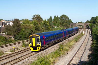The 13.23 Portsmouth Harbour to Cardiff Central formed of 158951 passes Undy. Friday 7th September 2012.