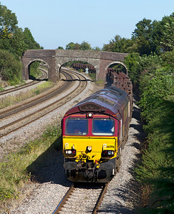 66096 passes Undy with 6V92 10.23 Corby to Margam empty coil carriers. Friday 7th September 2012.