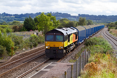 66847 drops down past Pilning Station with 6Z22 10.35 Gloucester New Yard to East Usk Yard new timber carrying wagon move. The wagons are converted cargo wagons and on arrival at East Usk Yard will be split into two rakes for onward transfer to Barry. Monday 10th September 2012.