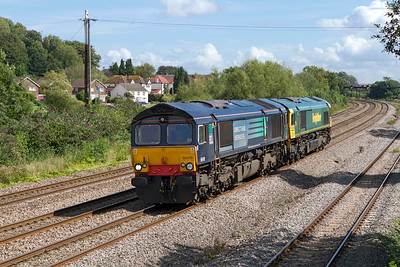 EX DRS 66419 now with Freightliner drags 66524 past Magor Village on an unknown working but by the sound of the wheel flat on 66524 they were heading to the wheel lathe at Cardiff Canton. Tuesday 28th August 2012.