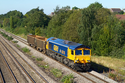66716 'LOCOMOTIVE & CARRIAGE INSTITUTION CENTENARY 1911-2011' passes Church Road, Undy with 6O27 09.20 Cardiff Tidal Yard to Tonbridge Yard wagon move. The wagons are to strengthen the rakes used on the Crossrail spoil trains. Friday 7th September 2012.