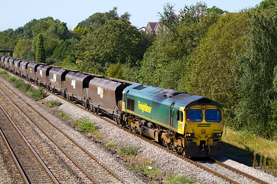 66514 passes Church Road, Undy with 4F56 10.42 Uskmouth Power Station to Stoke Gifford Yard empty hoppers. Friday 7th September 2012.