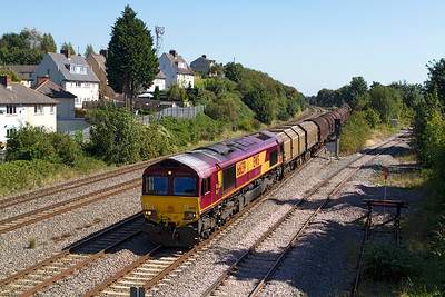 With 66139 looking as though it was on stone train duties prior to this heads 6M86 09.23 Margam to Dee Marsh via Llanwern loaded coil carriers past East Usk. Friday 7th September 2012.