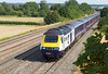 HP liveried FGW Power Car 43148 leads the 1W47 15.51 Paddington to Worcester Shrub Hill past Chosley Manor Farm. Thursday 1st August 2013.