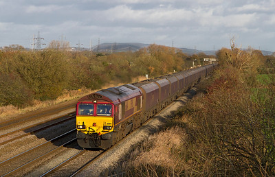 66114 heads along the relief at Coedkernew with 6V67 03.53 Redcar to Margam loaded coke hoppers, 7th December 2011.