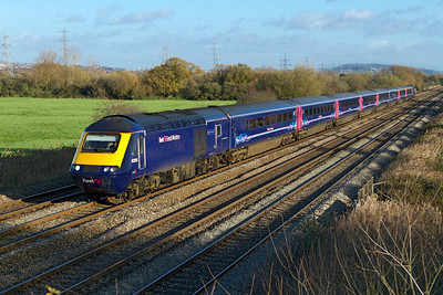 43056 'The Royal British Legion' and 43146 pass Coedkernew forming the 08.45 Paddington to Swansea. 07/12/2011.