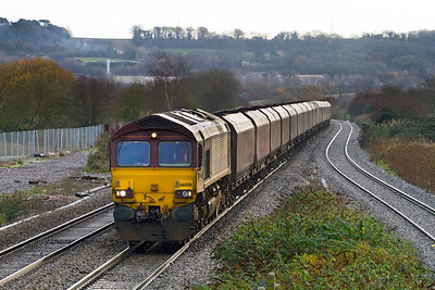 66050 'EWS Energy' drops down past Pilning station with 6B68 09.24 Avonmouth to Aberthaw loaded coal. 02/12/2011.