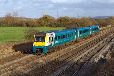175113 forming the 09.30 Manchester Piccadilly to Carmarthen passes Coedkernew. 07/12/2011.