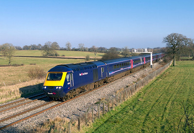 The 12.45 Paddington to Swansea with power cars 43176 & 43053 passes Acton Turville. Wednesday 1st February 2012.