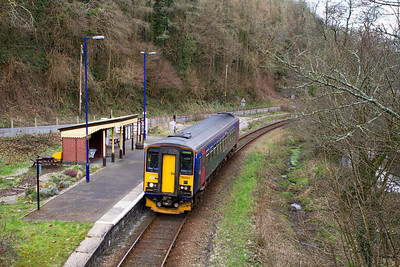 With no passengers waiting, 153361 runs straight through Sandplace forming the 14.47 Looe to Liskeard. Wednesday 16th February 2012.