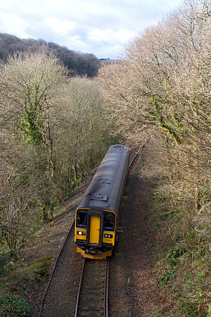 The 14.57 Looe to Liskeard climbs away from Coombe Junction past Lodge Hill on the approach to Liskeard formed of 153361. Wednesday 15th February 2012.