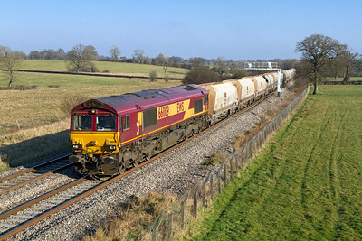 66009 passes Acton Turville with 6B35 10.47 Hayes to Morton-on-Lugg empty hoppers. Wednesday 1st February 2012.