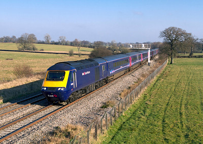 43125 & 43142 have charge of the 11.45 Paddington to Swansea passing Acton Turville. Wednesday 1st February 2012.