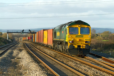 66534 'OOCL Express' Climbs past Pilning Station on Saturday 7th January 2012 with the 4O51 12.44 Wentloog to Southampton.