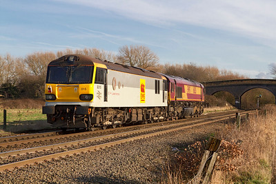 66126 heads away from Stenson Junction as 0D44 11.09 Bescot to Toton Departmental working with 92015 in tow. The Class 92 is bound for the paintshop at Toton for re-painting into DB red livery. Friday 13th January 2012.
