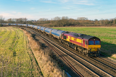 66007 heads away from Stenson Junction on Friday 13th January 2012 with 6E54 10.34 Kingsbury to Humber empty tanks.