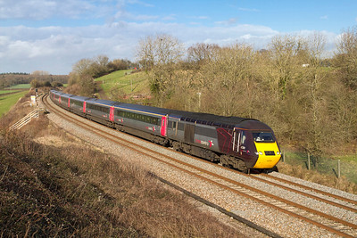 With power cars 43301 & 43303 in charge the 06.06 Endinburgh Waverley to Plymouth Cross Country HST service passes Huntingford running a few minutes late. Friday 27th January 2011.