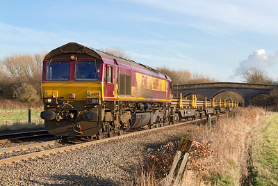 66019 approaches Stenson Junction with 6X01 10.17 Scunthorpe to Eastleigh loaded rail train. Friday 13th January 2012.